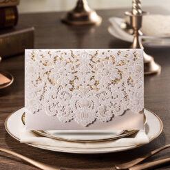 white laser cut hindu wedding invitation